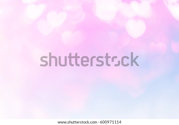 Pink blurred background of Valentine's day concept. Valentines Day Card. Pastel color tones.multicolored white hearts wallpaper.