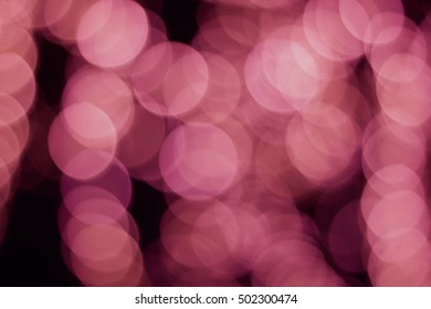 Pink blurred lights in the night