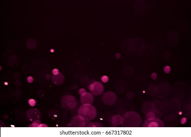 Pink bokeh abstract background caused by spray water.