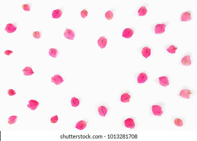Pink bougainvillea petals forming in heart shape. Flat lay, love and valentine concept.