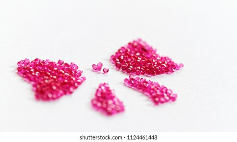 Pink bow of crystal beads on white background