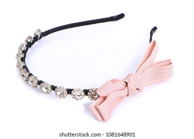 A pink Bow hair band on a white background