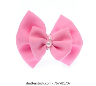 Pink bow with pearl isolated on white background.