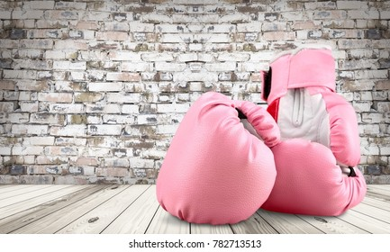 Pink boxing gloves on wooden table