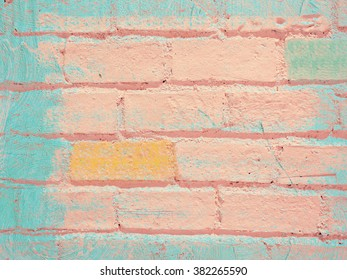 Pink brick wall with color paint on it