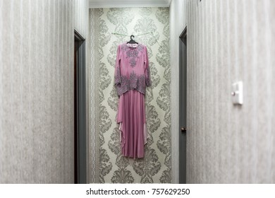 Pink bride dress hang on the wall