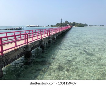 Pink bridge surrounded by clear underwater beach in Tidung Island, Thousand Island, Jakarta Indonesia