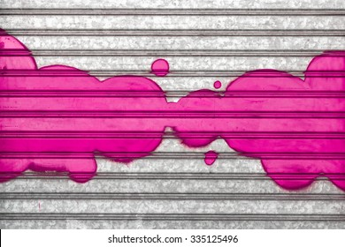Pink bubbles painted with spray paint on a roller shutter.