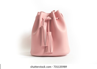 A pink bucket bag with fringe/tussle.