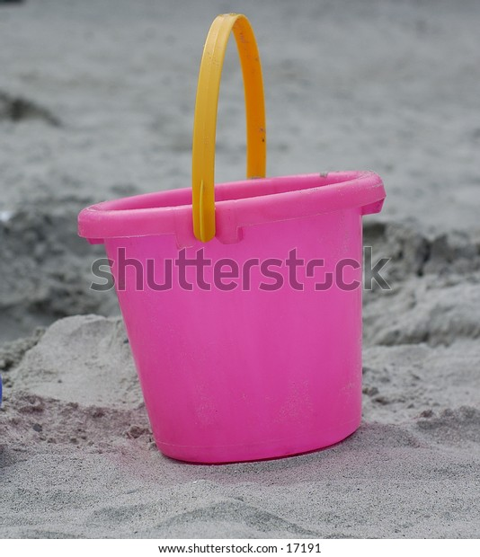 Pink Bucket in the sand