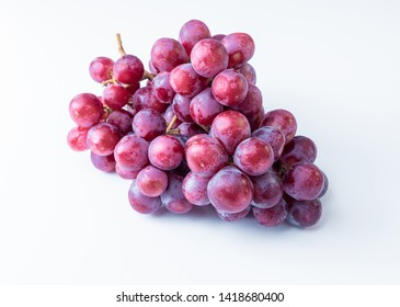 Pink bunch with leaves isolated on white. Organics grapes. With clipping path. Full depth of field.
