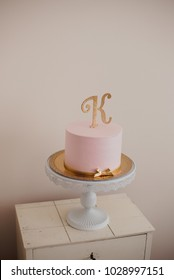 Pink cake with letter 'K'