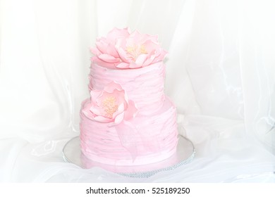 Pink cake with ruffles and flowers
