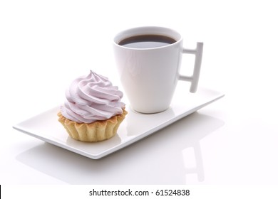 pink cakes and frash coffee on a white