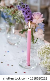 Pink cande on festive table