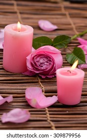 Pink Candles and rose, Petals on mat