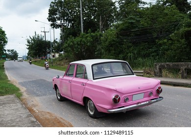 Pink Car on the Road