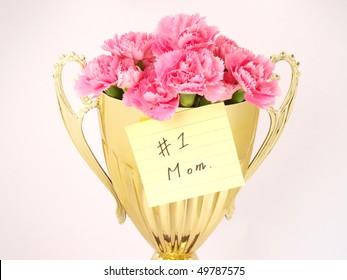 pink carnation in golden cup with post-it written #1 mom