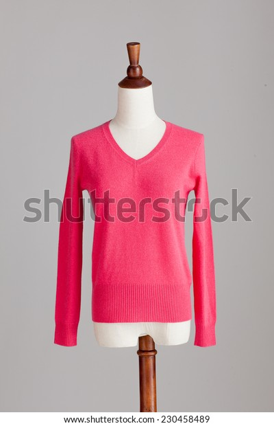 pink cashmere sweater with wood model on grey isolated