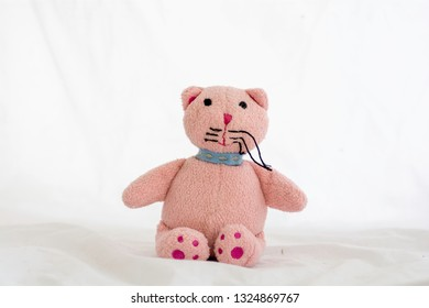 Pink cat doll on white background.
