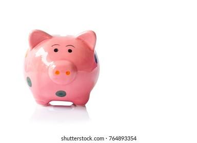 Pink ceramic piggy bank on white background, saving money concept