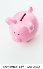 A pink ceramic piggy bank over a plain white background, viewed from the top.
