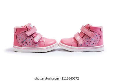 the pink children's sneakers isolated on a white background