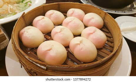 Pink Chinese Steamed Buns or Mantou.