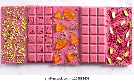 Pink chocolate with pistachio, candid oranges and dry raspberry