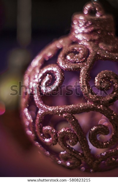 Pink Christmas ball with curlicues, studded with sequins