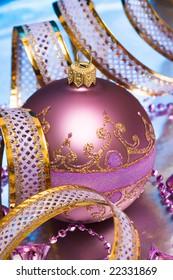 pink Christmas ball with ribbon