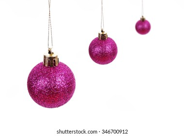 a pink christmas ball in a white background