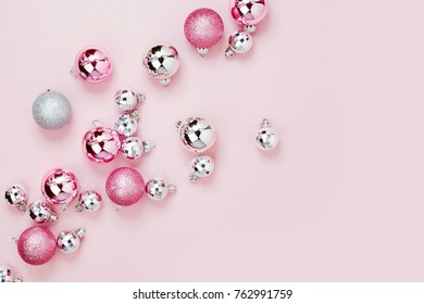 Pink Christmas balls background. Flat lay, top view