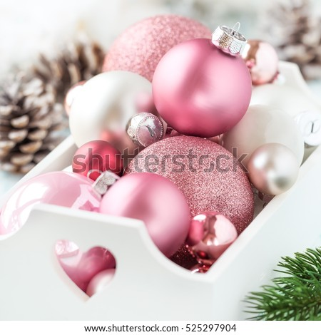 pink christmas baubles in a white shabby chic tray with christmas decorations at the background - Pink Christmas Decorations