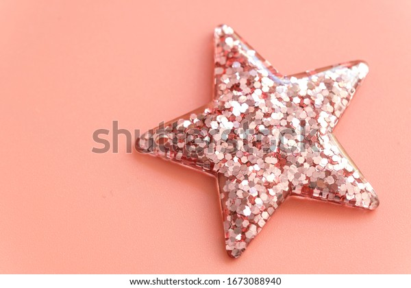 pink Christmas star isolated on pink background