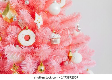 Pink Christmas tree and christmas decorations white and gold color.  Christmas background. Happy New Year and Xmas Christmas concept.
