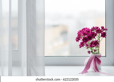 pink chrysanthemums bouquet in vase over window background