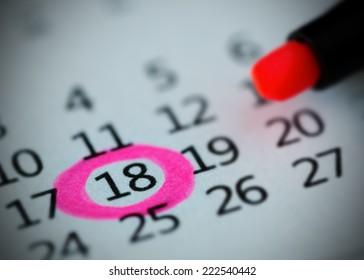 Pink circle. Mark on the calendar at 18.