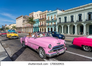 Pink classic convertible car used to give tourists rides through old Havana. Cuba. January 10, 2020.