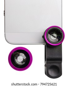 Pink clip lens for cell phone top view isolated on white background. Concept of mobile photography.
