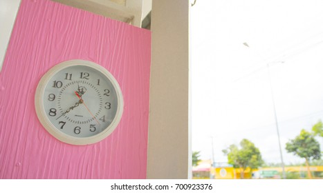 The pink clock with The blue sky