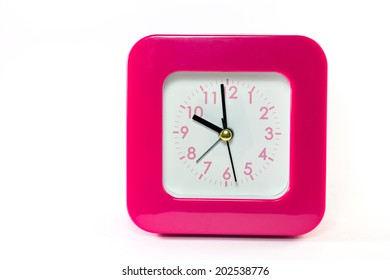 a pink clock isolated on white
