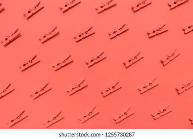 Pink clothes pins on the pink background. Horizontal. Ultra violet tone, color of the year 2018. Living coral theme - color of the year 2019