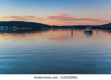 Pink Clouds and Boat on the Bay   - Capturing the sunrise from Woy Woy Waterfront on the Central Coast, NSW, Australia.