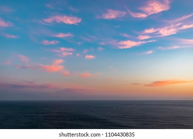 Pink clouds at sunset over the Atlantic Ocean, Sesimbra, Portugal