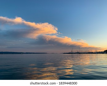 Pink clouds at sunset over the blue Adriatic Sea in Split, Croatia