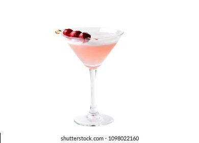 Pink cocktail with champagne and cocktail cherries in martini glass