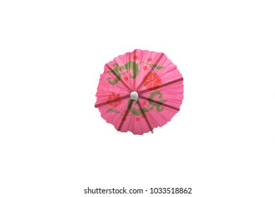 pink cocktail umbrella isolated on white background