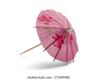 Pink Cocktail Umbrella Isolated on White Background.