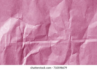 Pink color paper sheet surface with wrinckles. abstract background and texture for design.